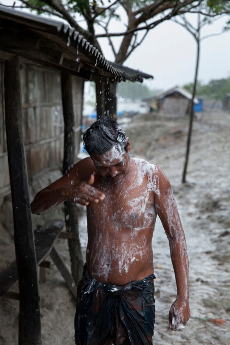 A man trying to shower in the rain but it has been stopped suddenly. Bangladesh is one of the countries most vulnerable to the effects of climate change. The regular and severe natural hazards that Bangladesh already suffers from – tropical cyclones, river erosion, flood, landslides and drought – are all set to increase in intensity and frequency as a result of climate change. Sea level rise will increasingly inundate coastal land in Bangladesh and dramatic coastal and river erosion will destroy lands and homes. These and the many other adverse effects of climate change will severely impact the economy and development of the country.One of the most dramatic impacts will be the forced movement of people throughout Bangladesh as a result of losing their homes, lands, property and livelihoods to the effects of climate change. While it is impossible to predict completely accurate figures of how many people will be displaced by climate change, the best current estimates state that sea level rise alone will displace 18 million Bangladeshis within the next 40 years. The vast majority of these people will be displaced within Bangladesh – not across international borders – presenting the Government with enormous challenges, particularly when it comes to finding places to live and work for those displaced.