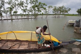 Ased Ali Gazi is a fisherman, prepares to catch fishes. Thousands of men and women go into the Sundarbans forest in Southern Bangladesh every day to gather honey, collect firewood, or catch fish, crabs and putting themselves at great risk for a tiger attack.