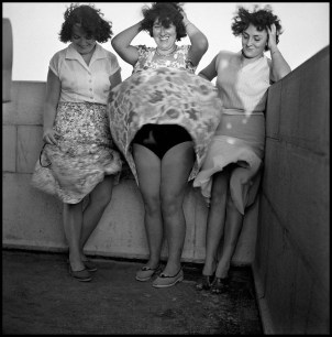 """""""This is one of the very first pictures I took. It was 1956 at the top of Antibes lighthouse on the French Riviera and I was a young boy. The woman in the middle with her hands in her hair and a bright smile is my mother. As the wind blew up her skirt, and before Marilyn made the move famous, I stopped hiding behind her. I was 15 years old, but it didn't take me seven years to develop the itch to take pictures!"""" - Guy Le Querrec"""