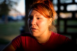 Bree crying and waiting at the park after she left her husbands house because they were fighting. She went back to his house later that night. (Williston, ND / August 2015)