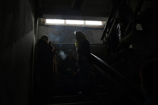 Residents of Debaltseve waiting in an underground shelter to get food from local NGO. Debaltseve was a scene of heavy fighting between UA army and Pro Russia rebels, eventually it fell to rebel hands.