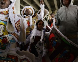 "The «Black Indian» battles during carnivals show another vision of the past. These groups, organised into about 40 tribes or «gangs» in New Orleans' urban areas, play a fundamental role in the historical reconstruction of native American and black resistance through the development of the ""Suits"" tradition . Despite having no public support, they have been working from the 19th century to revive the symbols of the Native Americans and Black resistance, in order to re-appropriate the past. These groups also chose to present a select view of black society, emphasising its connection with Indian civilisation while erasing any links to the White community, which stands to stain any idea of original purity. Thus, the Louisiana carnival has become a high place of dramatisation of identity and heritage, offering a local reconstruction of history and heroes. The carnival is a central point of convergence for Louisiana's cultural identities. ""Suits"", acclaimed as authentic contemporary art pieces, are traditional elements of the carnival. They are symbols of disorder, and are linked to rural areas. They are primal and belong to the earth and swamps. It is a world that belongs to native Americans and maroon slaves. A world at the margins of society. An outlawed world. Whenever the «Suits» or Black Indians emerge from the countryside to invade the frightened city, there appears on the scene a deluge of popular representations that systematically associate them with savages, uncivilised native warriors, maroon slaves, whose rebellious and defiant reputations need to be kept intact. By invading the urban space, Suits who moved massively to the city centre undoubtedly cunningly schemed with the American morality to survive. This symbolic movement carries a huge emotional charge, as Suits convey the wounds of a history that is as violent as its denial. From the series CASTA, Race, Memory and Community in the southern United States"