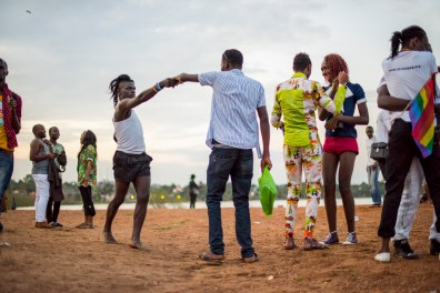 After the Pride march, members of the LGBT community and their supporters celebrate into the evening on the shores of Lake Victoria in Entebbe, 40 km from Kampala. Safety concerns made it impossible to hold the march in a more public location like downtown Kampala. Entebbe, Uganda. August 8, 2015. © Diana Zeyneb Alhindawi