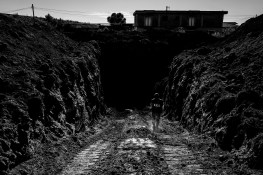 """Member of State Forestry Corp enters an illegall legal dump site, revealed by Carmine Schiavone, pentito, former high-ranking member of the Casalesi clan. Casal di Principe - Naples June, 15 2016 Especially in small towns like Casal di Principe, by burying the waste in its backyard near Naples and the surrounding region of Campania, Camorra ensured a measure of protection, and silence. Bosses often exert a powerful influence over the local economy and politicians, """"The inhabitants are all at risk of dying from cancer within twenty years,"""" said Carmine Schiavone, repentant and former treasurer of Casalesi clan, in his secret testimony. """"In towns like Casapesenna, Casal di Principe, Castel Volturno, and so on, they have, perhaps, twenty years to live. In fact I don't think anyone will survive"""" continued Schiavone. I was brought to the site by the activist Enzo Tosti. I didn't influence the scene in any way."""