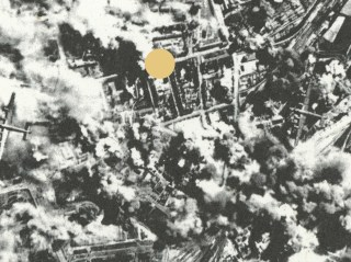 A small piece of a photo of the bombing of Kiel out of a book I found on the streets of Buenos Aires on World War II, intervened by the dots that resemble the holes in my inherited memory.