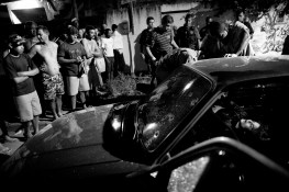 A crime scene were 3 people were shot dead inside of a car in a slum in Santa Cruz, on the outskirts of Rio de Janeiro. Rio de Janeiro is considered one of the most violent cities in the world, having an average of 18 people assassinated on a daily basis.