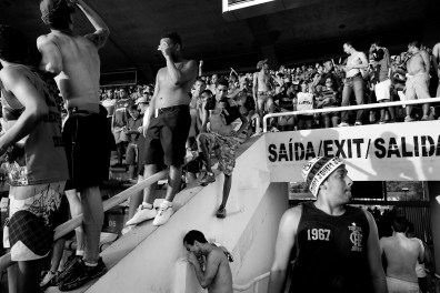 A man snores cocaine at the entrance of the Maracana stadium tribune during a football match between Flamengo and Goias. The Maracana is one of the biggest stadiums in the world and will host the final of the 2014 World Cup in Rio de Janeiro.
