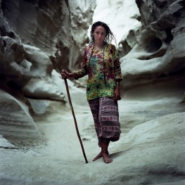 Sahar with her walking stick, poses for a portrait in a salt cave on Qeshm island, dressed for inside. The island has become a place where young people can experience more freedom away from the Islamic republic's restrictions to a certain extent.