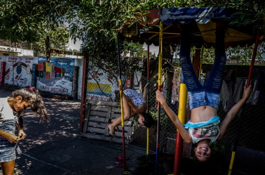 Buenos Aires, Isla Maciel. Young girls playing inside the convent for children in distress property of the Foundacion Isla Maciel.