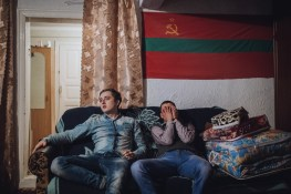 Alyosha and Yura are sitting under the flag of Transnistria.