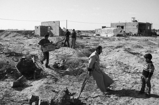 Samir Al Daberi is seen walking in his bulldozed land near the buffer zone in Rafah, southern Gaza, Palestine, on Nov. 6th 2014. Samir got his leg amputated during the second war in Gaza. His farm in Rafah was bulldozed during the war in 2014, so he had to hire workers to remove ruined olive trees. Al Daberi family used to live in the farm, but their house was destroyed during the last war, so they had rent another home.