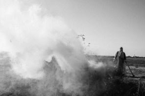Ms. Abu Rauk is burning the overgrown bush on her farmland in Khan Younis on Nov. 3rd 2014.