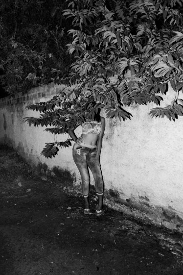 BOA VISTA, BRAZIL - JULY 17, 2017: A twenty six year old prostitute coming from Venezuela is portrayed while she was waiting for clients in a street of Boa Vista, the capital of the Brazilian state of Roraima. She crossed into Brazil to raise money to send back to Venezuela to buy medicines for her daughter. She said that had no choice but to resort to prostitution. Nowadays thousands of Venezuelans have crossed into Brazil, in the main cities of the Amazon region like Boa Vista and Manaus, to fled the humanitarian and political crisis in Venezuela.