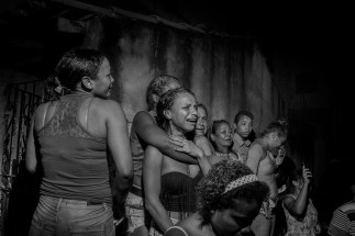BELEM, BRAZIL - MAY 23, 2015: Relatives of inmates detained inside the Cremacao police imprisonment facility in Belem, the capital of Pará state. The people above react after hearing the gun shots of a special operations police squad, who fired their weapons while suppressing a revolt inside the prison. The rebellion started due to the conditions of overcrowding inside the cells: 212 inmates shared a space designed for 92 people.
