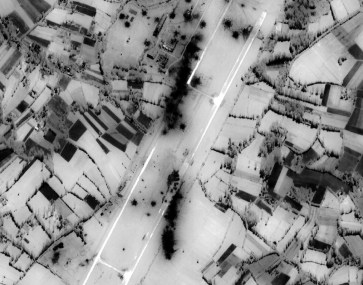 990512-O-9999M-003 Post-strike bomb damage assessment photograph of the Obrva Airfield, Serbia, used by Joint Staff Vice Director for Strategic Plans and Policy Maj. Gen. Charles F. Wald, U.S. Air Force, during a press briefing on NATO Operation Allied Force in the Pentagon on May 12, 1999. DoD photo. (Released)