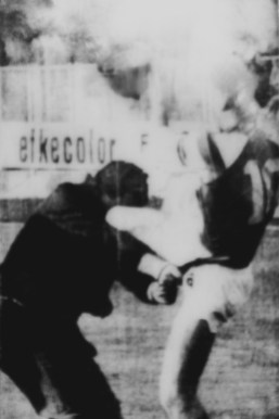 An abandoned poster found in a suburb of Belgrade. This image, a man who numbered 10, Zvonimir Boban, famous Croatian footballer kicked a Serbian policeman in the riot of Maksimir on 13th May 1990.