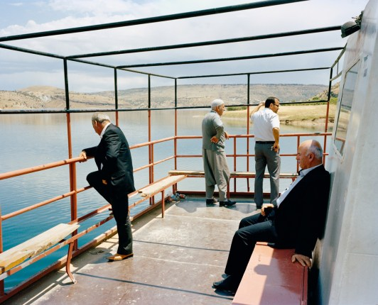 Commuters on a ferry boat traveling across the Keban dam on the Euphrates river located in eastern Anatolia. Keban, Turkey