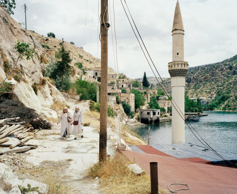 Local tourists visiting the former village of Savaçan flooded by the reservoir lake of the Birecik Dam in 1999 located on the Euphrates river. Turkey