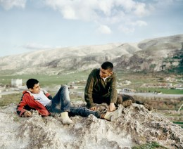 Young farmers are standing on top of a hill dominating the banks of the Tigris river. The Ilisu dam project due in 2018 will flood 80% of the ancient monuments of Hasankeyf along with 52 other villages and 15 small towns by 2018. Kesmeköprü, Turkey