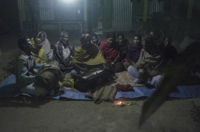 A group of Hindu men and women were in the evening prayer at a house in Kursherhaat village near the international border of India and Bangladesh.