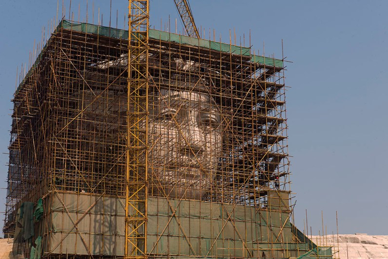 A new sculpture of Mao ZeDong was being constructed in Changsha, the place he went to middle school. The sculpture stands tall in a new park.