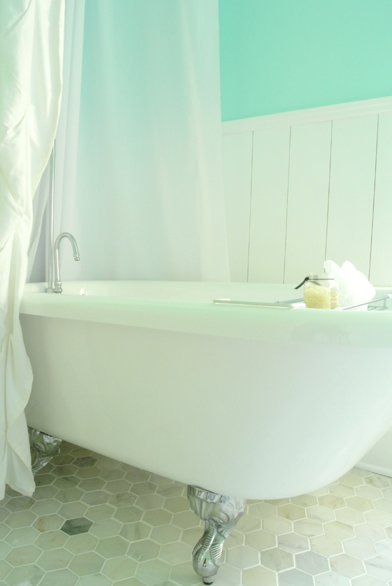 clawfoot tub in an urban cottage bathroom renovation, from BurritosandBubbly.com