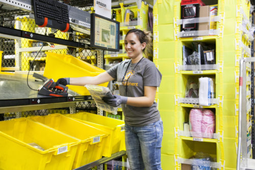 An employee inside an Amazon fulfillment center.