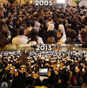 These two photos taken just eight years apart at the announcements of the two most recent Popes was used by Twitter's Melissa Barnes to illustrate how quickly the world has embraced the mobile digital age. Credit: Luca Bruno/AP, Michael Sohn/AP