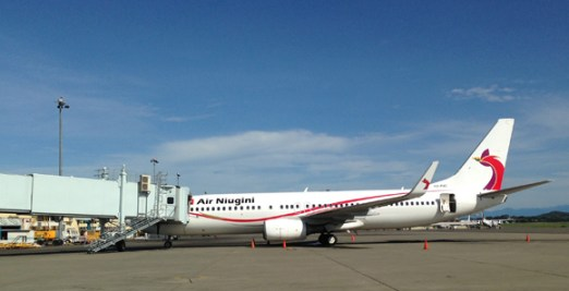 An Air Niugini plane arrives at Port Moresby's Jacksons International Airport