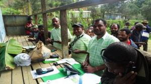 Coffee farmers sign up for their first bank account. Credit: The Loop