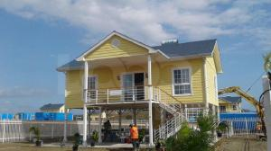 A new housing project near Eight-Mile, just outside of Port Moresby, launched last month. Credit: PNG Loop