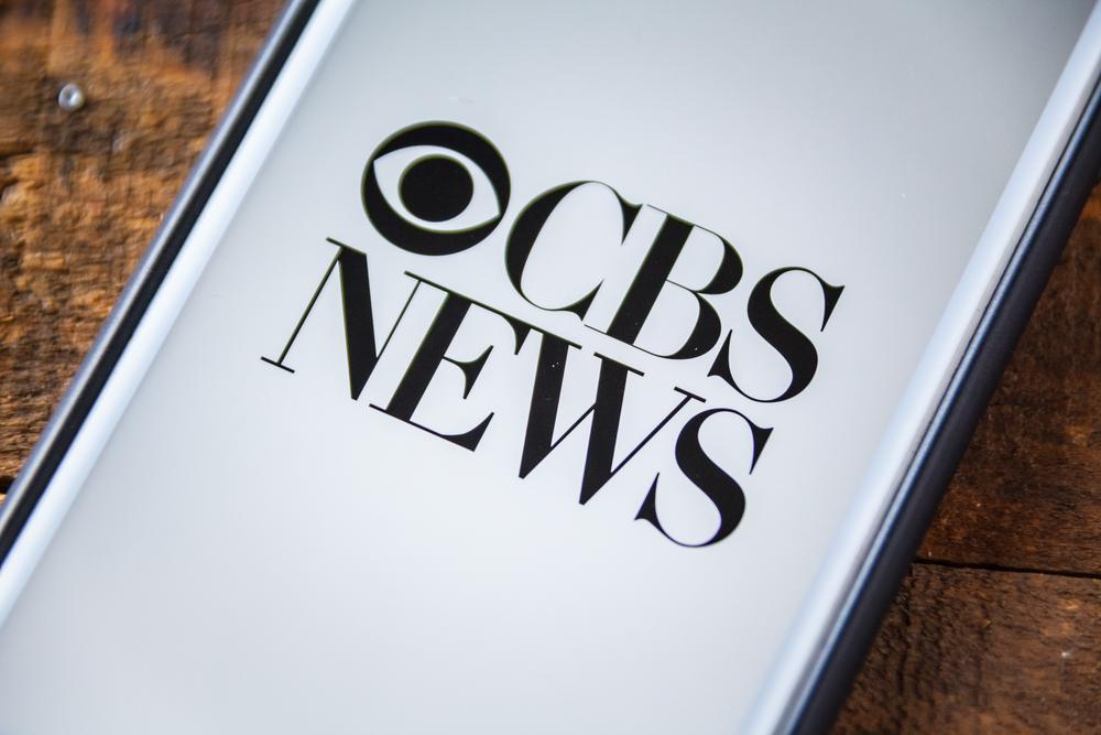 CBS News logo shown on phone screen.