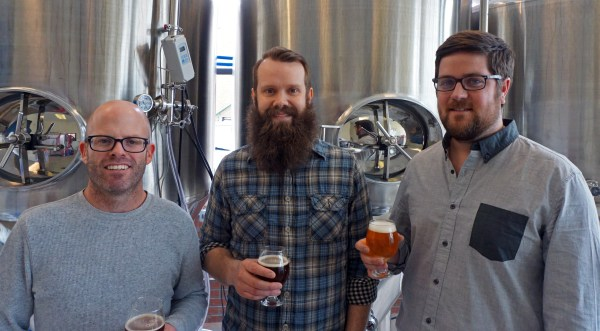 From left: Taylor Rees, Austin Wiley and Darren Boyd and  launched Spangalang Brewery last week. Photos by Burl Rolett.
