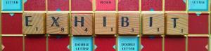 exhibit-word-spelled-with-scrabble-tiles