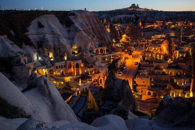 Rocky homes line the cliff face in Nevsehir, Turkey, also known as the Cappadocia region. The area is popular with tourists for its Byzantine art and large network of underground Bronze Age troglodyte dwellings.