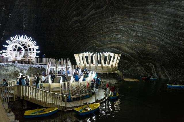 This 400-foot-deep amusement park was constructed in a former salt mine in Romania, called the Salina Turda. Inside, you can ride an underground ferris wheel, paddle in a lake, play ping pong, and see performances at an amphitheater.