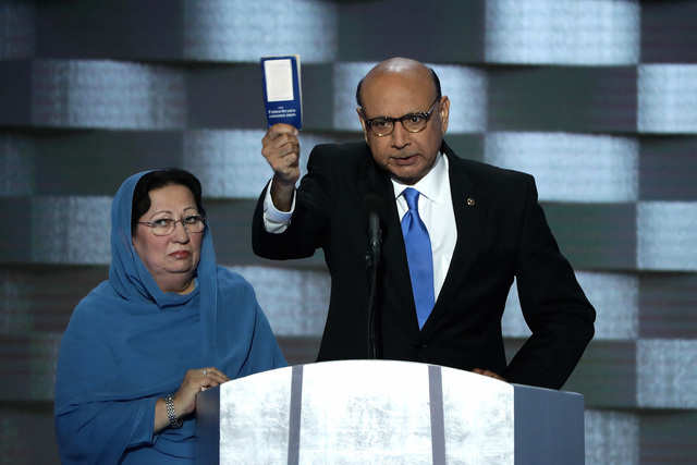 Following Donald Trump's divisive call for Muslims to be barred from entering the United States, Hillary Clinton allowed the parents of a Muslim soldier who died in Iraq to speak at the Democratic National Convention. In this picture, Khizr Khan holds up a a booklet containing the country's constitution while asking if Trump has ever read it.