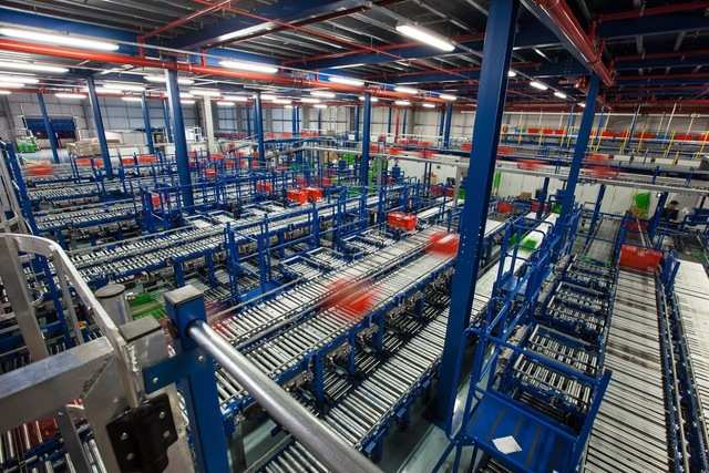 Located outside Birmingham, one of Ocado's warehouses measures 350,000 square feet and ships over 1.3 million food items per day to people's doors.