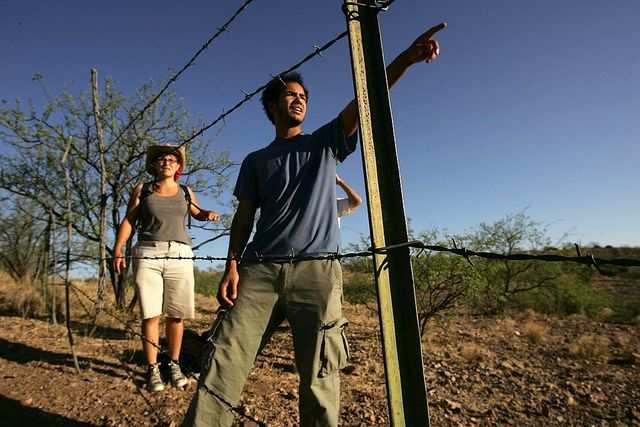 From 1998 to 2006, over 2,650 men, women, and children died attempting to cross the US-Mexico border. In the picture below, members of the humanitarian group No More Deaths search for migrants in distress in 2006.