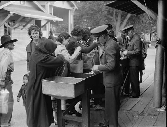 Much like today, people coming from Mexico were required to open their bags and suitcases at the border. In this 1937 photo, an agent inspects the possessions of shoppers going from Juarez, Mexico to El Paso, Texas.