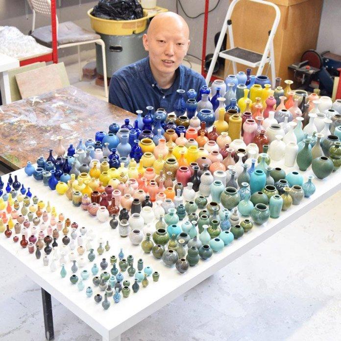 artist yuta segawa hand-throws thousands of tiny ceramic vases