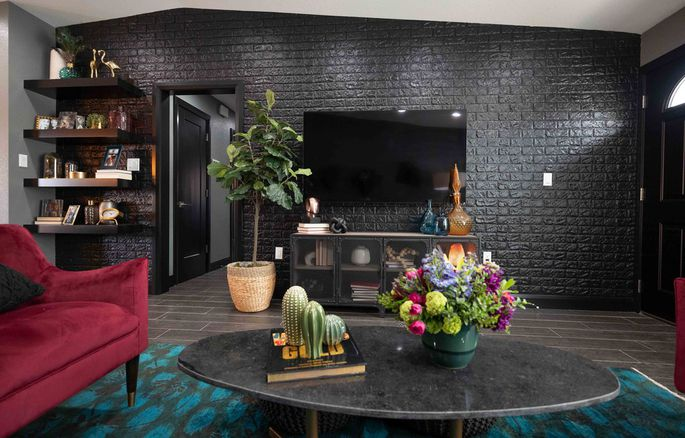A black accent wall covered with foam brick sheets