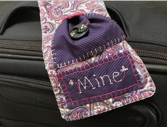 Hand embroidered luggage tag from Joanna Taylor.