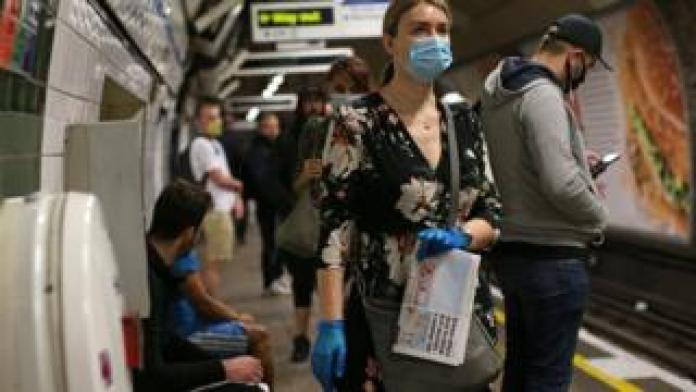 Commuters in face masks