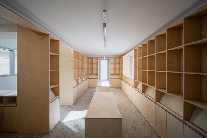 stpmj architects renovates residential building into press company in seoul