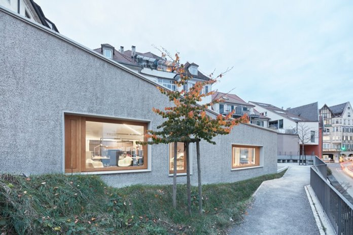 dannien roller architekten balances neoclassical fabric of tübingen with modern extension