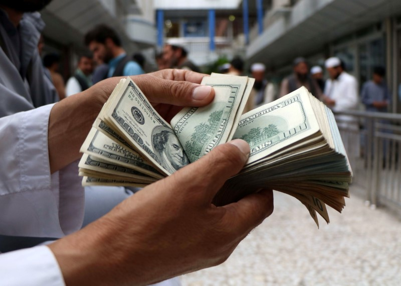 Dollar Up, But Gains Capped by Strong Earnings, Increasing Risk Appetite