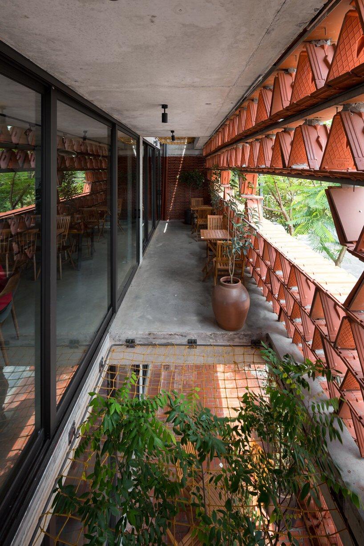 H&P architects wraps 20,000 tiles around 'ngói space' in hanoi, vietnam designboom