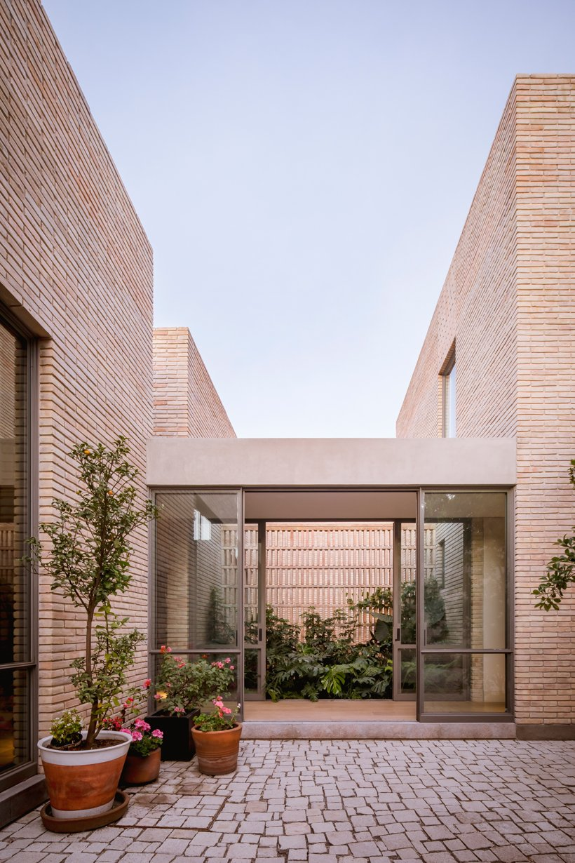 asps white clay brick residence revolves around interior courtyards in mexico city 5
