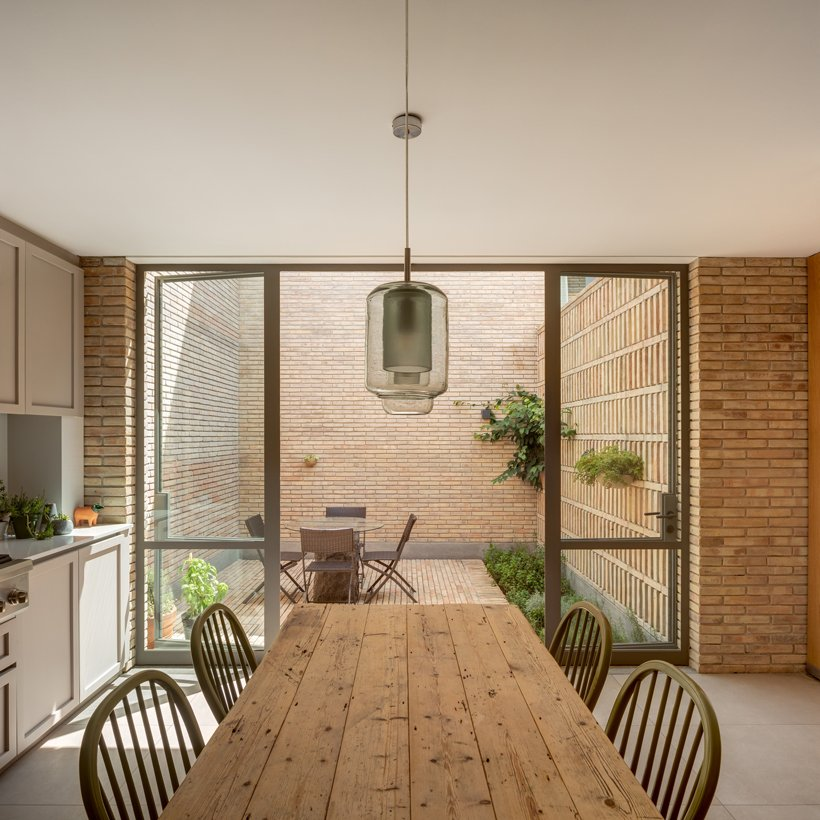 asps white clay brick residence revolves around interior courtyards in mexico city 8
